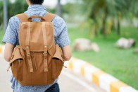 close-up-young-traveler-man-carrying-backpack-for-trip-concept_42708-102